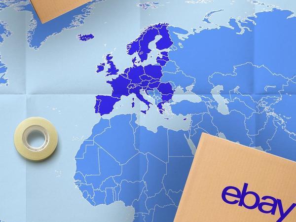 colis eBay posé sur carte du monde